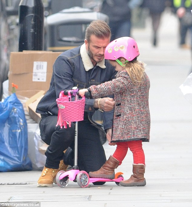David Beckham looks proudly on his daughter Harper 4