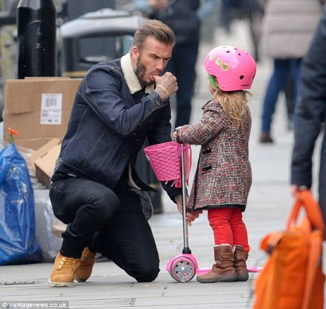 David Beckham looks proudly on his daughter Harper 6