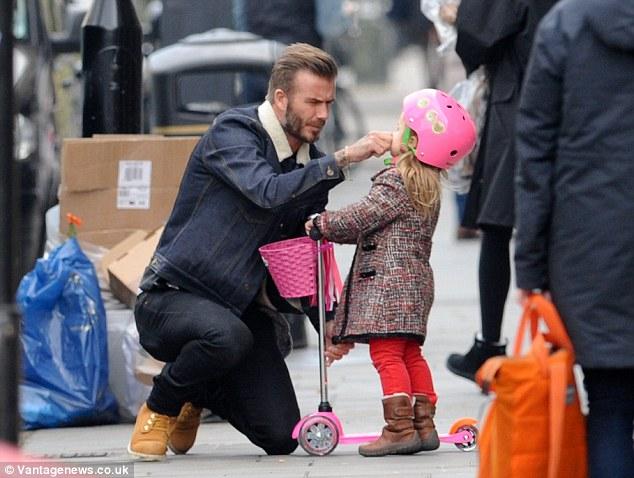 David Beckham looks proudly on his daughter Harper 7