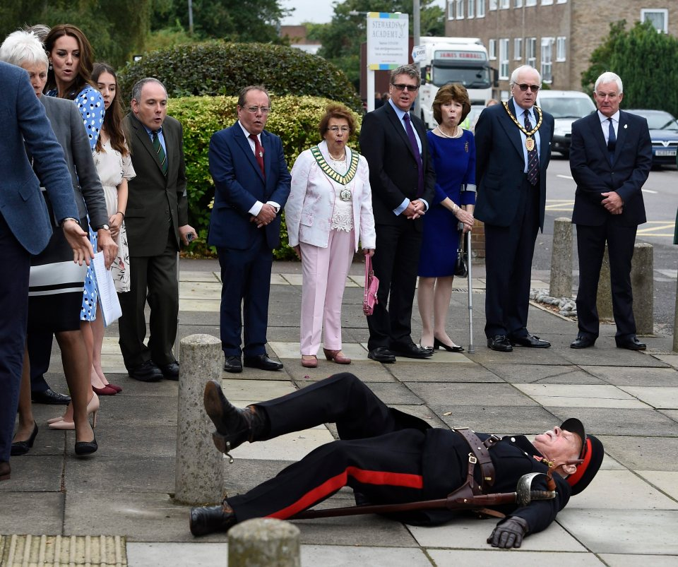 epa05542059 HRH Catherine, The Duchess of Cambridge (2-L) and others react after Jonathan Douglas-Hughes (C), OBE, Vice Lord-Lieutenant of Essex, tripped over a concrete bollard during the visit of the Duke and Duchess of Cambridge visit Stewards Academy in Harlow to the Stewards Academy in Harlow, Essex, Britain, 16 September 2016. EPA/FACUNDO ARRIZABALAGA