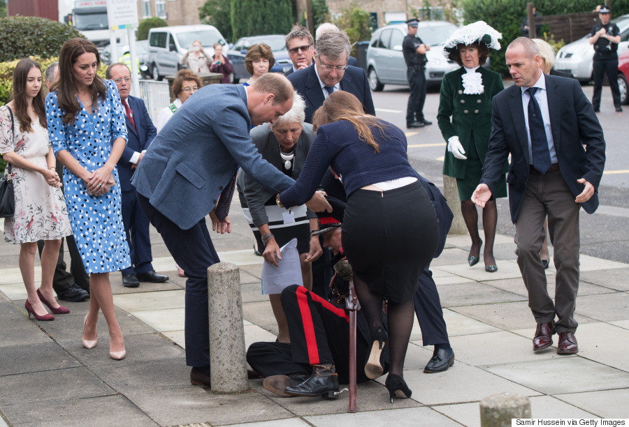 HARLOW, ENGLAND - SEPTEMBER 16: Catherine, Duchess of Cambridge looks on as Prince William, Duke of Cambridge helps up Jonathan Douglas-Hughes, vice Vice Lord-Lieutenant of Essex after his fall at Stewards Academy on September 16, 2016 in Harlow, England. (Photo by Samir Hussein/WireImage)